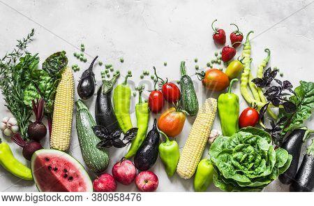 Summer Vegetables Harvest Background. Organic Garden Vegetables, Berries, Fruit On A Light Backgroun