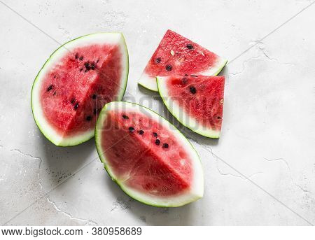 Fresh Ripe Watermelon On A Light Background, Top View. Vegetarian Diet Food Concept