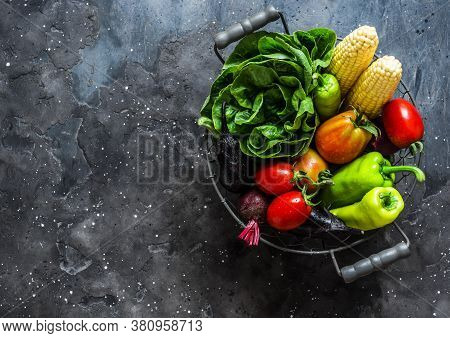 Raw Vegetables. Eggplant, Zucchini, Tomatoes, Corn, Pepper, Lettuce In A Vintage Metal Basket On A D