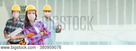 Female and Male Contractors In Hard Hats Wearing Medical Face Masks At Construction Site During Coronavirus Pandemic Banner.