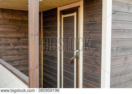 Door Of A Wooden House, Bathhouse. Gorizontal Photo