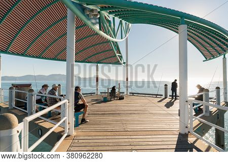 Townsville, Australia - June 20, 2019: Fishermen In The Morning On A Warm Winter's Day On The Strand