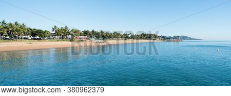 Clear Blue Sky And Palm Tree Lined The Strand Beach, Townsville With Blue Sea