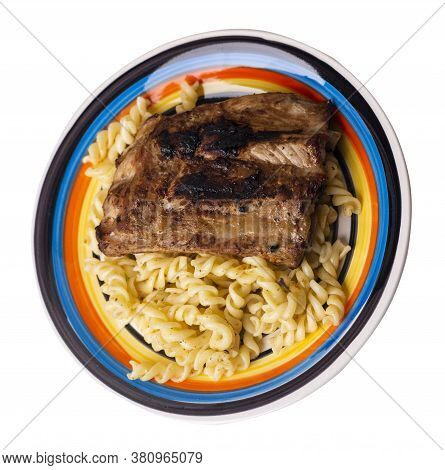 Grilled Pork Ribs With Pasta. Grilled Pork Ribs On White Black Blue Red Yellow Plate Isolated On Whi