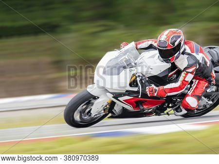 Motorcycle Racer Is Accelerating Speed In Track