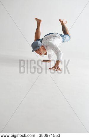 Stylish Smiling Guy Breakdancer Dancing Lower Break Dance Isolated On White Background. Dance School