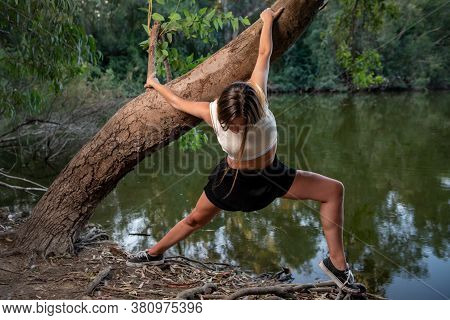 Young Contemporary Dancer And Choreographer Dancing Outdoors Woman Dancing In The Environment.