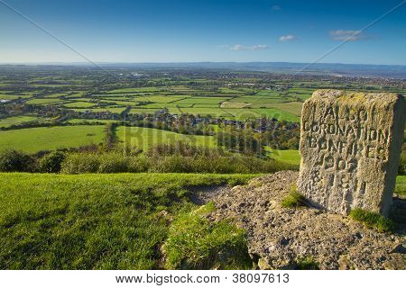 Brent Knoll hill on the Somerset Levels in Somerset, England.  It is located half way between Weston-super-Mare and Bridgwater with views of Bristol Channel coast and inland to Crook Peak and Glastonbury Tor. poster