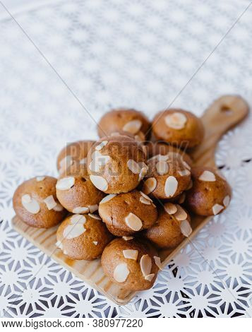 Selective Focus Stack Of Homemade Muffin On Wooden Tray With White Table And White Background