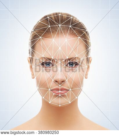 Portrait of attractive woman with a scnanning grid on her face. Face id, security, facial recognition.