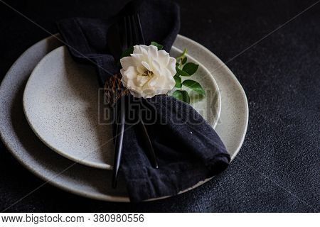 Minimalistic Table Setting With White Rose