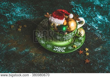 Chirstmas Mug Full Of Holiday Decoration On Green Stone Background With Copy Space
