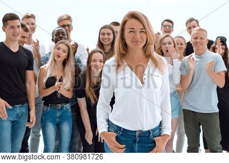 confident young woman leader standing in front of her associates