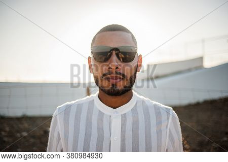 Portrait Of A Confident And Casual Man, Modern Muslim Wearing Sunglasses