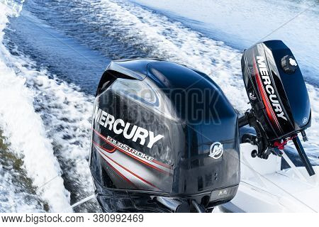 Sankt-petersburg, Russia, August 8, 2020:  Modern New Fishing Sport Boat With A Brand New Mercury Fo