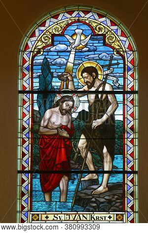 GORNJA STUBICA, CROATIA - SEPTEMBER 16, 2012: Baptism of the Lord stained glass in the parish church of Saint George in Gornja Stubica, Croatia