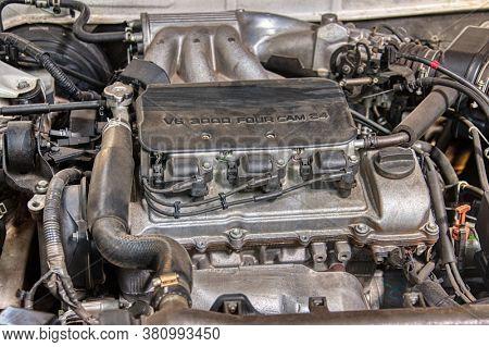a vintage V6 carburetor engine up for repairs
