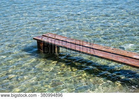 Weathered Wooden Small Pier Over The Sea At Kea, Tzia Island, Greece.