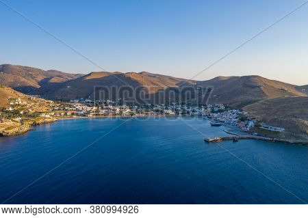 Kea Tzia Island, Cyclades, Greece. Aerial Drone Photo Of The Port At Sunset Time.