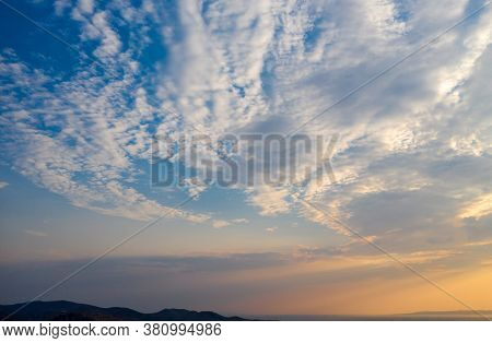 Sunrise, Sunset Clouds Over Land Silhouette And Sea. Twilight, Dusk Cloudy Sky