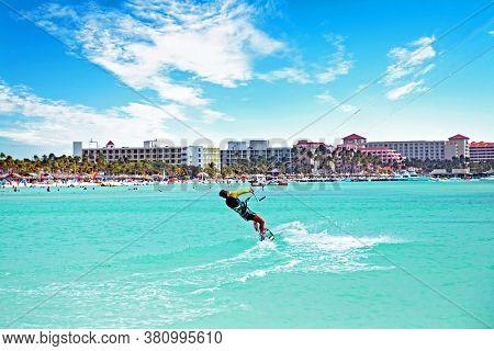 Kite surfing at Palm Beach on Aruba island in the Caribbean Sea