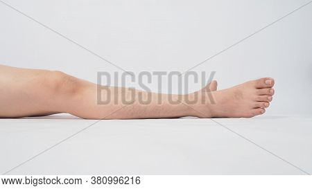 Male Leg Is Isolated On White Background
