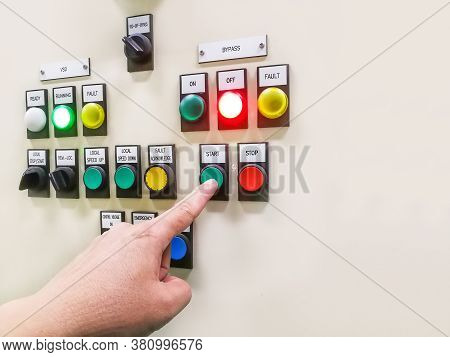 Hand Holding The Control Panel Of The Industrial Plant And Pushing Or Turning The Button In Electric