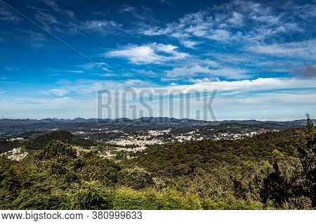 City View With Mountain Range And Bright Blue Sky From Hill Top At Day Image Is Taken From Doddabett