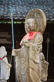 Japanese Buddha Statues (Jizo Bodhisattva) over a Graveyard poster