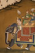 Wall painting of traditional Indian scene in Jaipur capital of Rajasthan India. poster