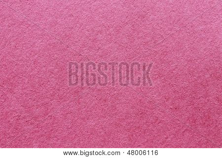 close up aka macro shot of pink construction paper, showing texture, paper fibers, flaws, and more. the perfect image for all your colored construction or recycled paper needs