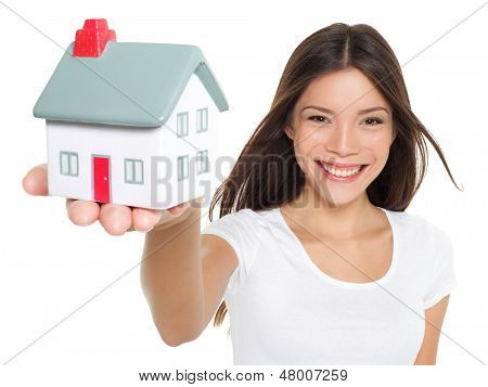 Home / house. Buying new home concept - woman holding mini house. House mortgage and happy home owner conceptual image with multi-ethnic Asian Chinese / Caucasian female model on white background. poster