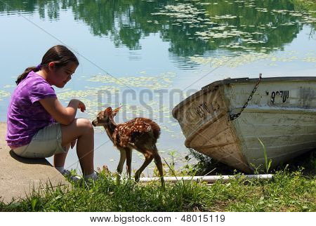 Girl and Fawn Connecting