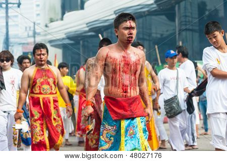 PHUKET, THAILAND- OCT 23: Unidentified participant of parade on October 23, 2012 Vegetarian Festival Phuket Thailand. The Festival is a famous annual festival also known as Nine Emperor Gods festival