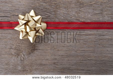 Golden Bow On Red Ribbon