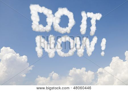 Do it now concept text words in clouds on blue sky