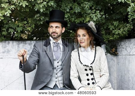 Old-fashioned Dressed Couple In The Park