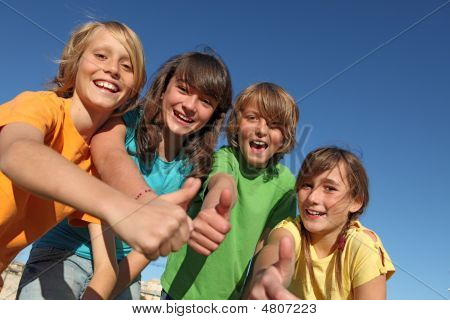 Happy Group Of Kids With Thumbs Up
