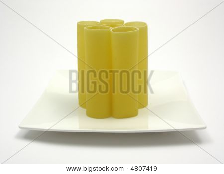 Several Canneloni Standing On A White Plate