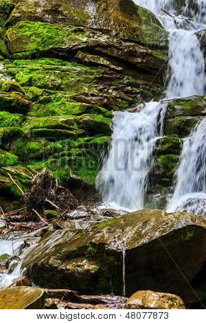 Mountain Stream On Wet Rocks With Moss