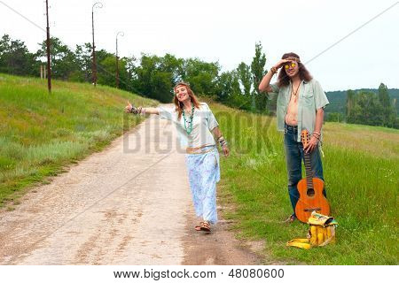 Couple Hitchhiker Hippie On The Road
