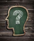Human head chalkboard with question mark concept poster