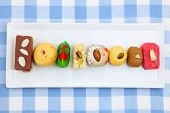 Colorful Indian sweets in the plate poster