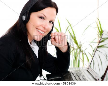 Smiling Brunette Woman With Headphone In Office