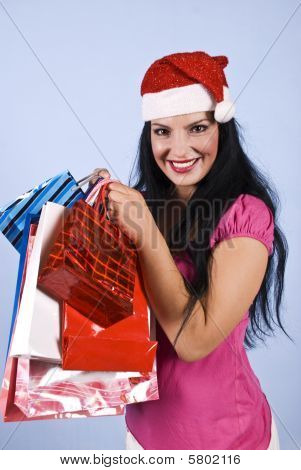 Happy Woman With Santa Hat And Christams Bags