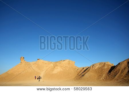 Group Of Tourists Climb On Camel Head Rock