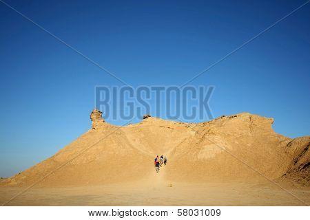 Tourists Climb On Camel Head Rock