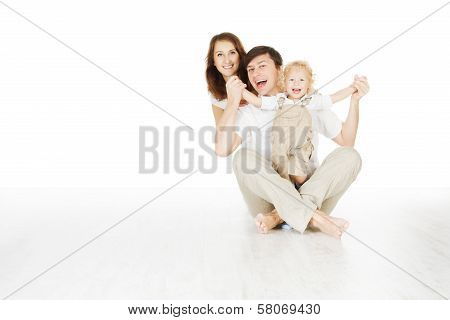 Happy Family, Smiling Father Mother And Laughting Baby