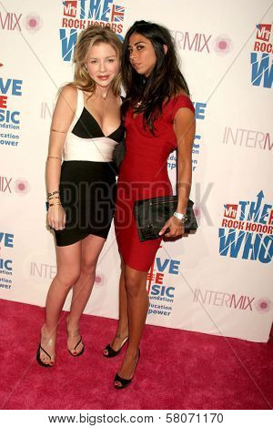 K.C. Johnson and Courtenay Semel  at the VH1 Rock Honors Party. Intermix Boutique, Los Angeles, CA. 07-11-08