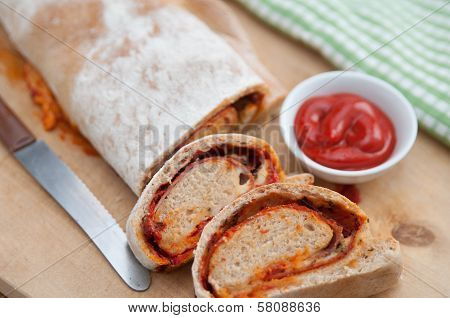 Stromboli - italian sandwich filled with ham and cheese